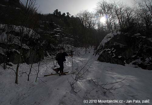 We continued on skis through narrow part between rocks