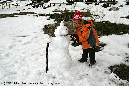 Snowman in front of hut Chata pod Soliskom is finished