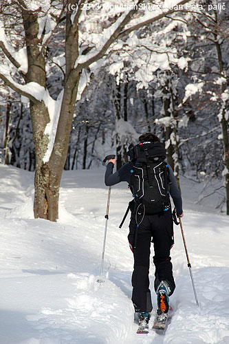 A skialpinist from Višňové is running up the hill
