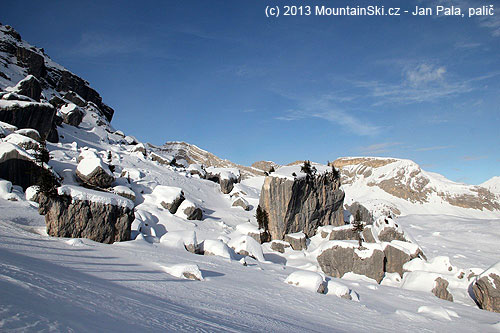 Snow was taken away by wind– a group of shadows just passed stones and rocks, that are usually mostly covered bysnow