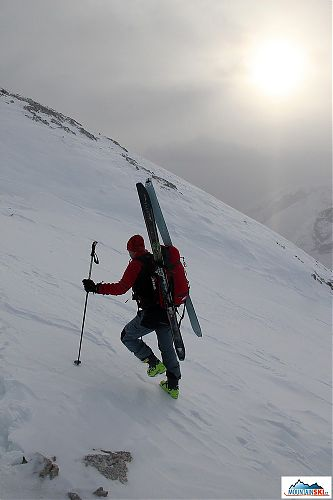 We reached the ridge on feet with skis attached to backpacks