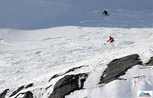 Excellent skiing just above rocks - heliskiing from CMH Galena lodge
